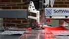 缝纫机器人自动化生产线,一端进布料一端出T恤,全程无人参与!
