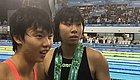 泳池中捞出一枚铜牌 中国青奥团奖牌开和